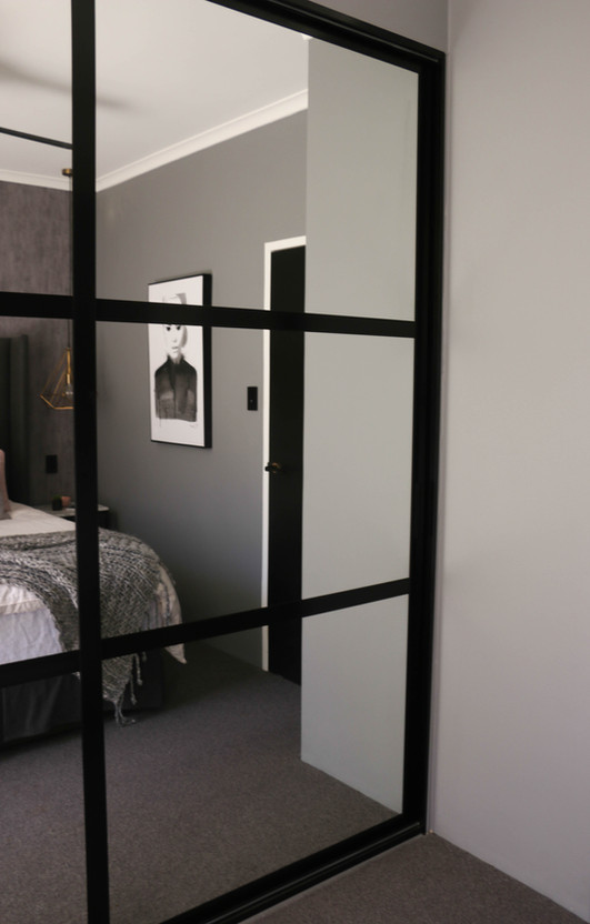manly master bedroom - custom black panel mirrored wardrobe