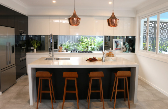Freshwater - contemporary/industrial kitchen - black and white, with copper pendant lights and timber bar stools. Glass window splashback.