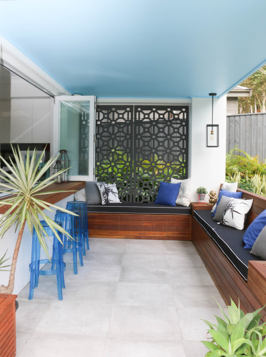 freshwater exterior - casual seating area; blue, white, timber, concrete