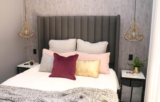 manly master bedroom - modern industrial, brass pendant cage light, marble bedsides
