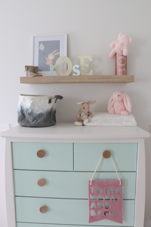 Freshwater - contemporary/scandi - Nursery - pastel colours. Soft, calming. White timber furniture. Feature geometric print feature wall.