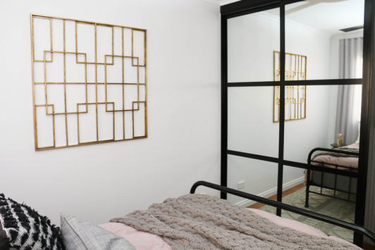 manly guest bedroom - modern industrial - grey pink, brass artwork