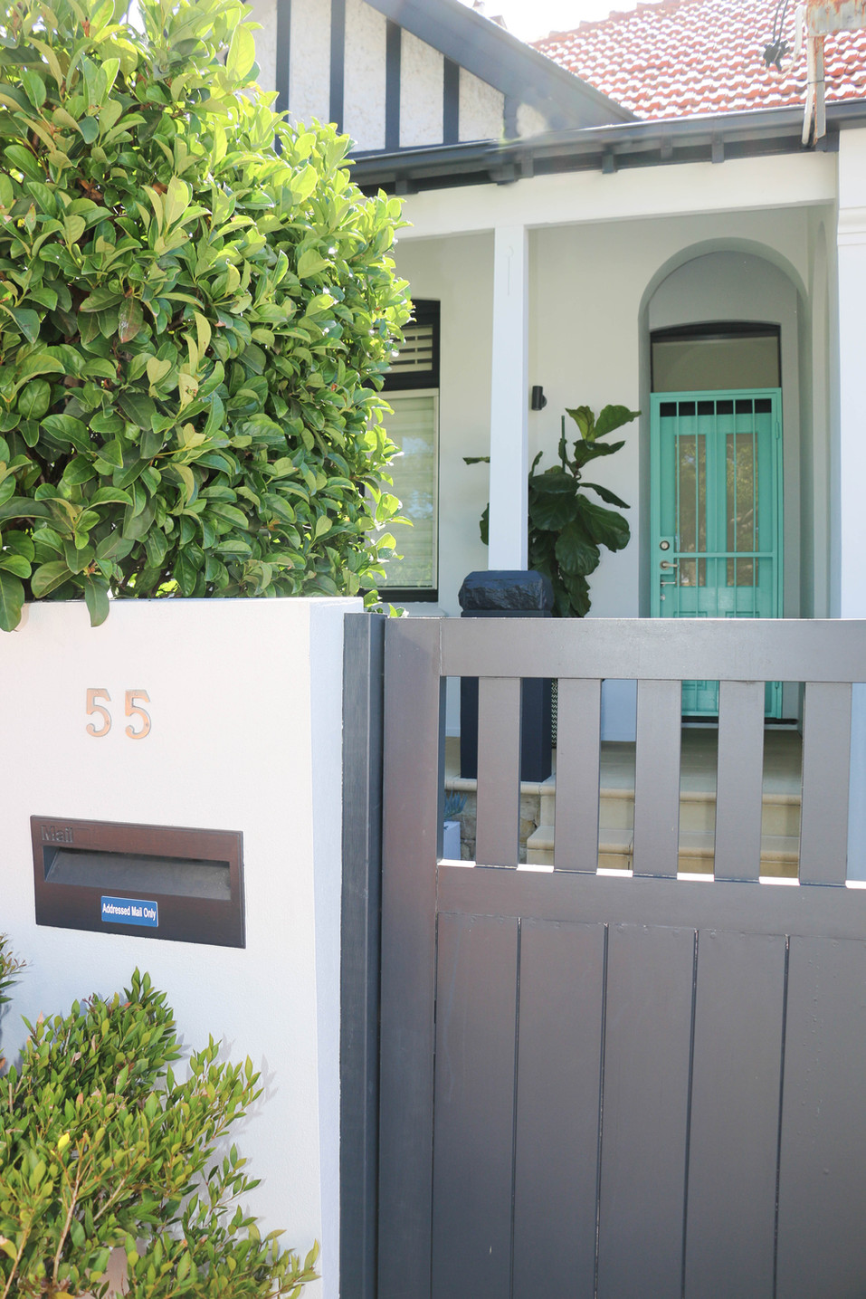 manly modern classic - front exterior white grey with aqua door