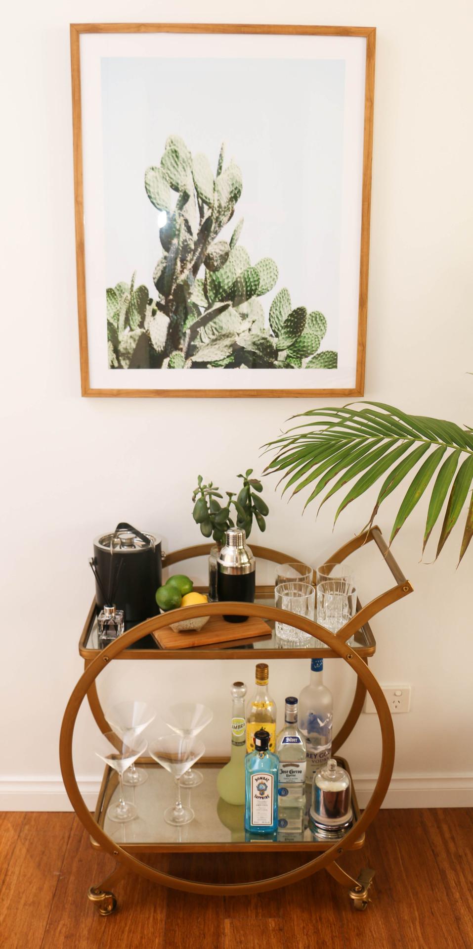 manly modern glam dining room - brass drinks trolley