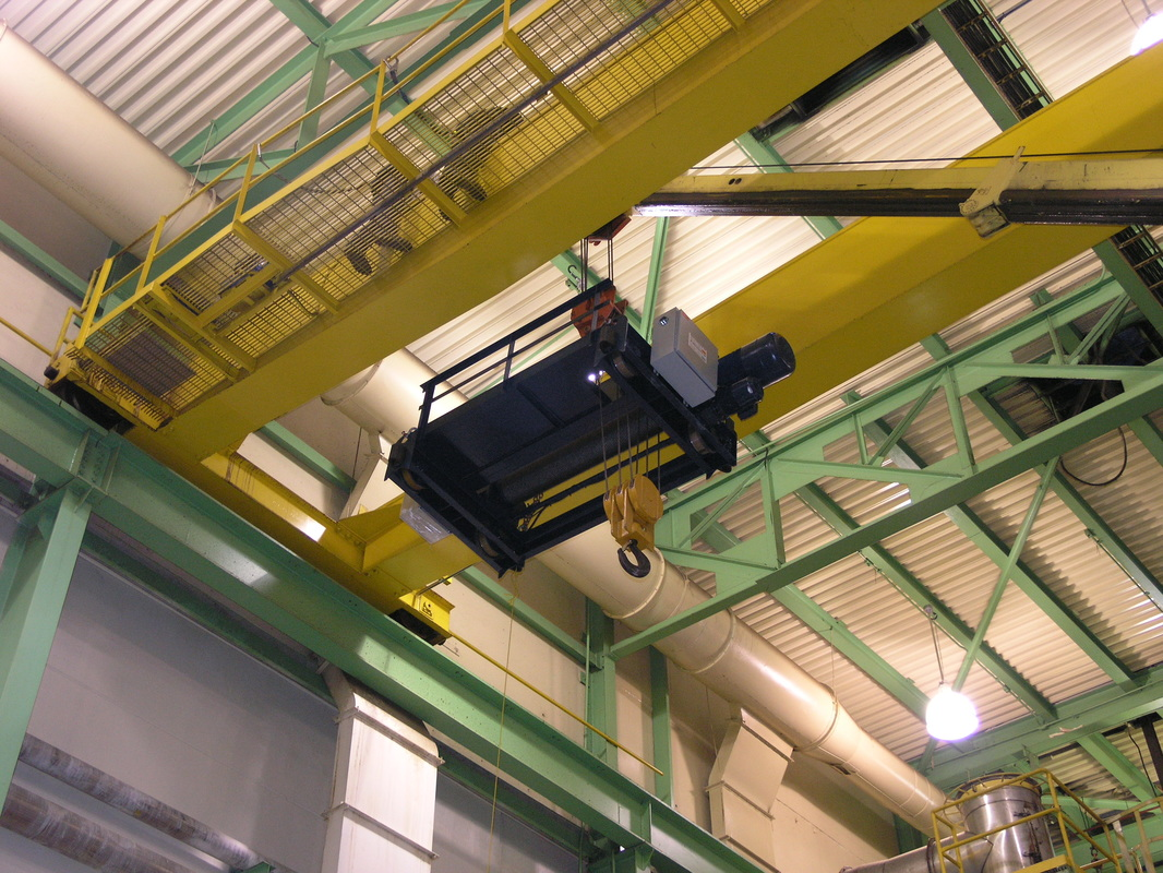 Top running trolley hoist being installed