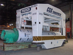 Munck Cranes Custom DesignBattery operated cart for moving rolls in a paper mill