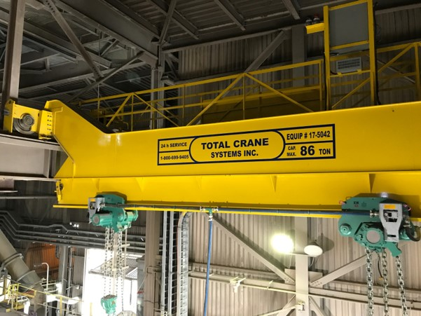 Special crane for transferring heavy rolls from bay to bay. Trolley assembly runs onto a Monorail be
