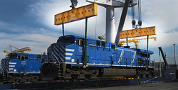 Lifting a 490,000 pound locomotive onto a ship with custom made slings and load beams