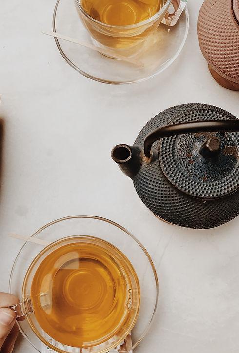 black ceramic teapot on white ceramic saucer_edited_edited.jpg