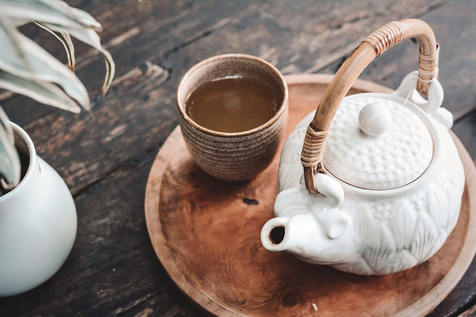 white and brown ceramic teapot on wooden tray_edited.jpg