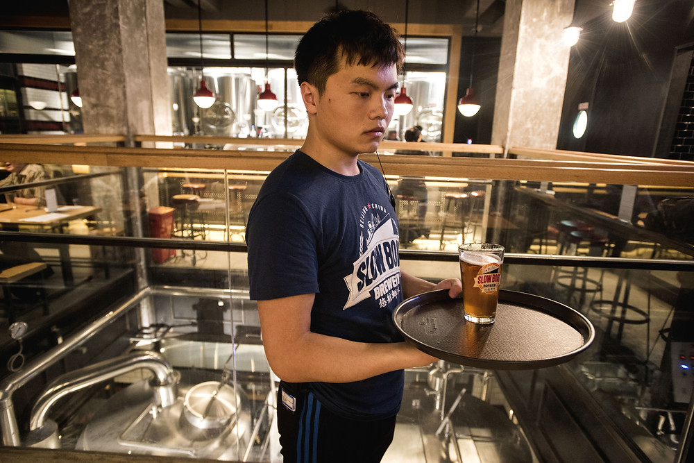 A server at Slow Boat, a pioneering Chinese craft brewery.