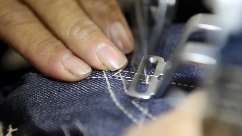 jeans making sewing machine closeup
