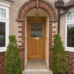 Made to measure solid oak door with leaded glazed unit. Supplied and fitted by keystone timber windo