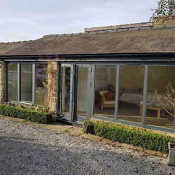 French doors and fixed units in #anthracite really made this converted out building stand out