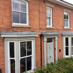 Front elevation of last weeks project timber box sash bay windows and hardwood french door