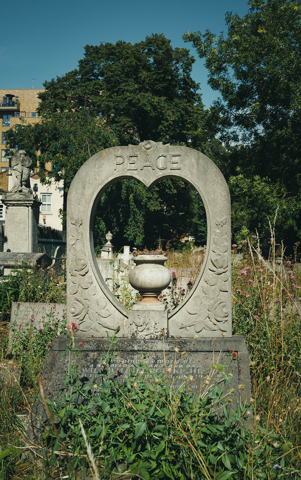 Photograph of a tomb stone in Tower Hamlet Cemetery in East London.