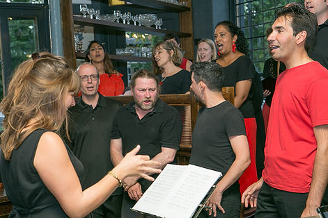 Conductor and Tenors in Action at Concert