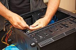 Computer technician installs system of c