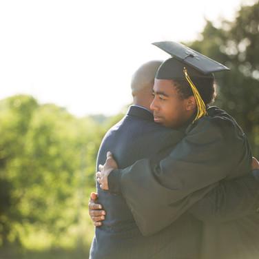 Father hugging son at grad