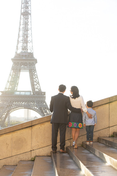 family enjoys the view on the Eiffel tower