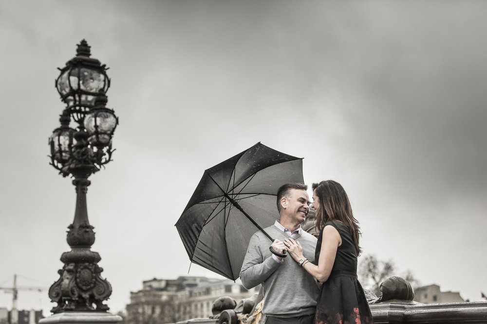 couple with umbrella in paris