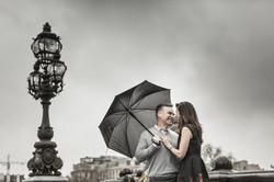 couple with umbrella in paris