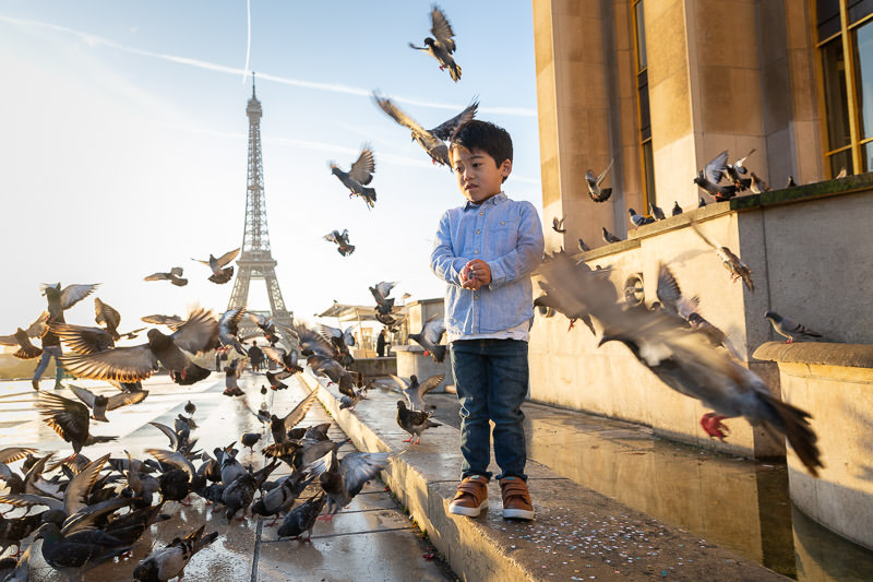 Kid with pigeons at the Trocadero