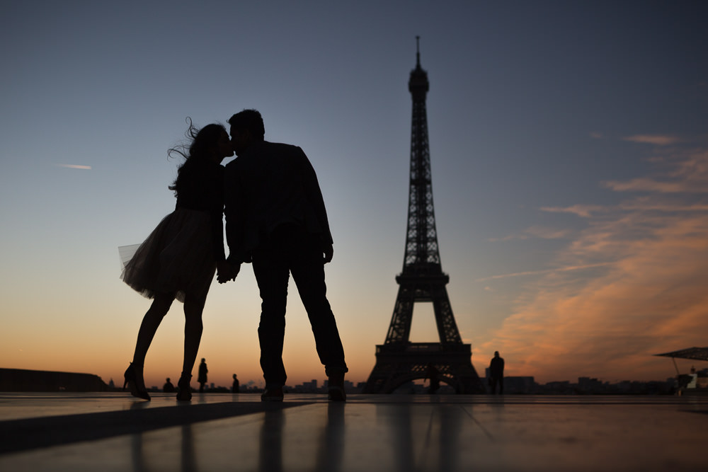 silhouettes in front of Eiffel tower