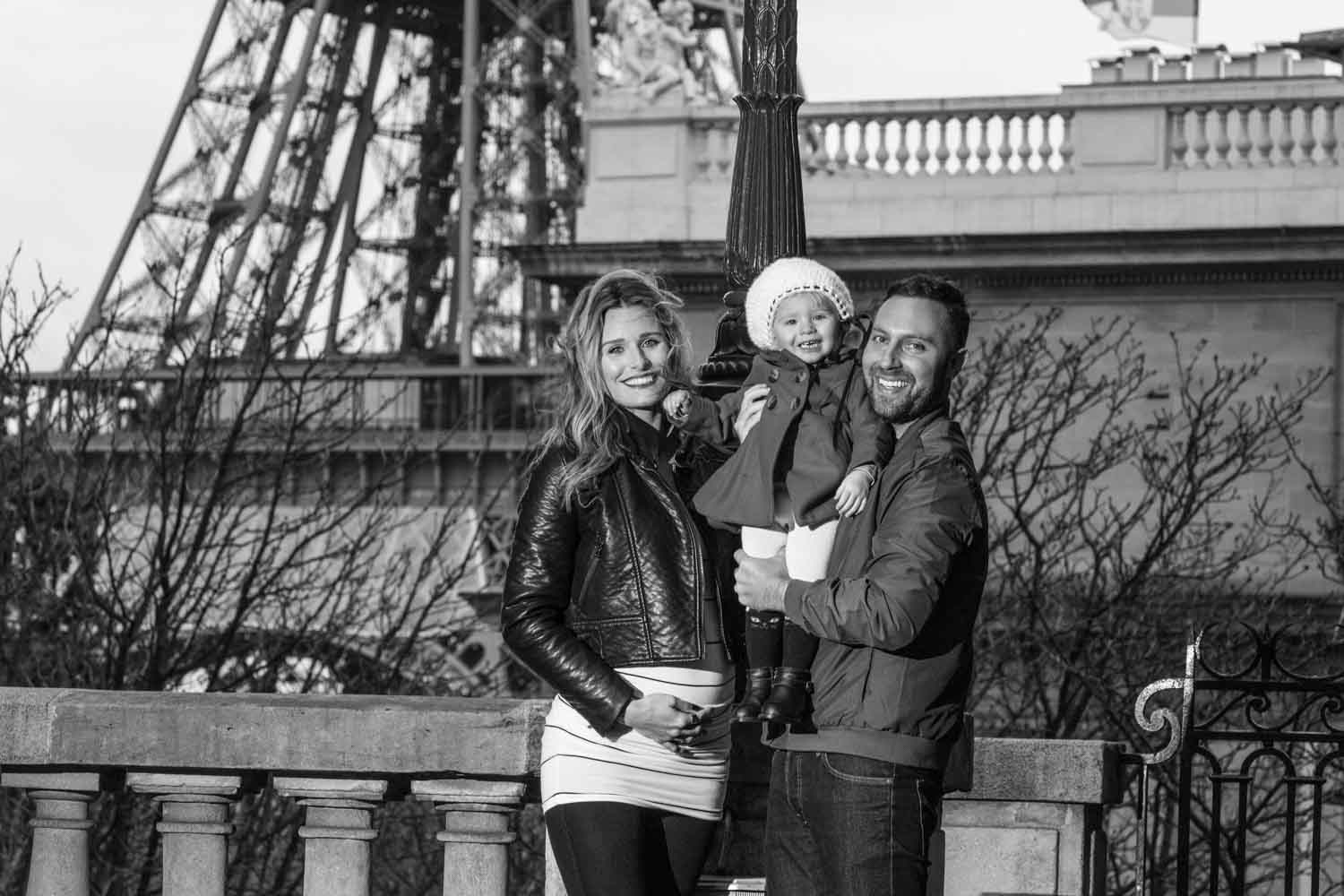 couple with baby in paris