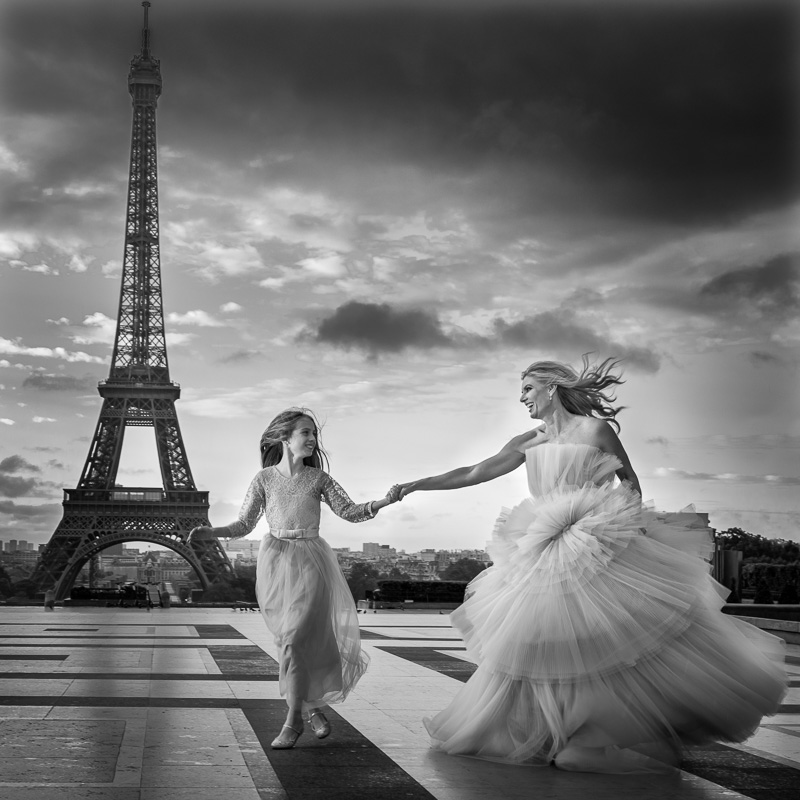 Mother and daughter running in Paris