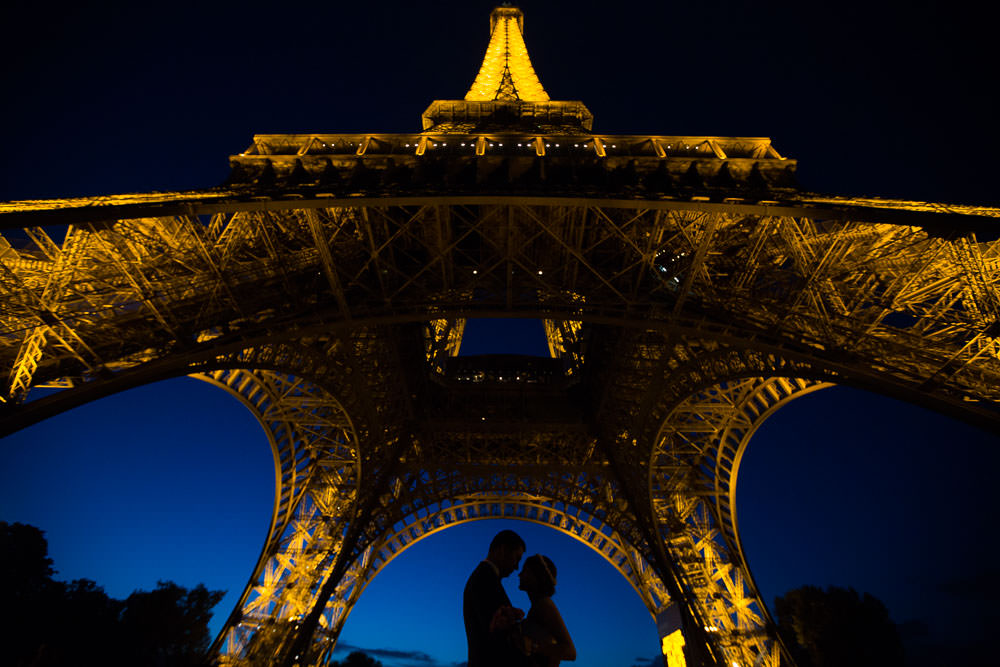 silhouette couple under Eiffel tower