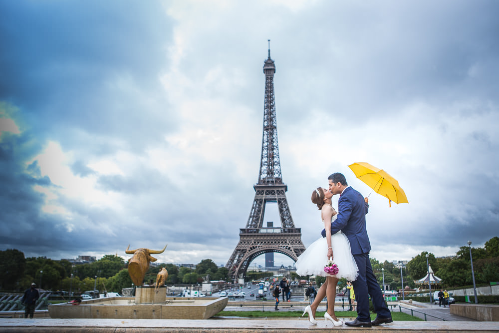 couple under the rain at Trocadero