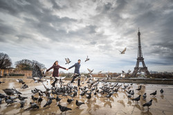 couple with pigeons in paris