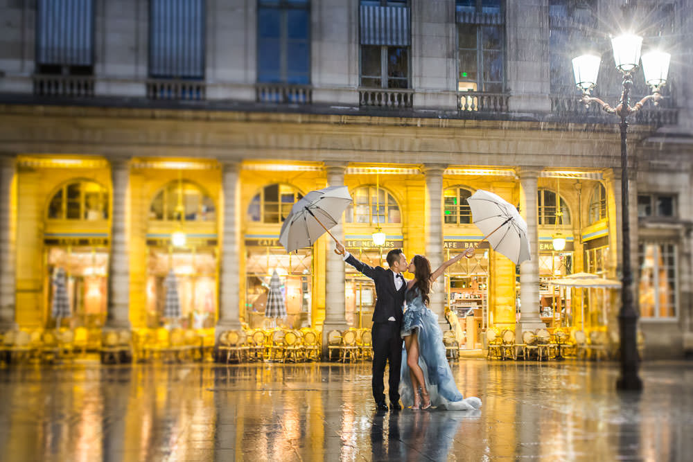 Couple with umbrella under the rain