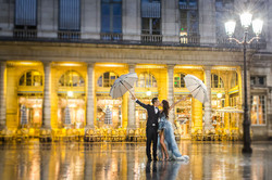 Couple with umbrella under the rain