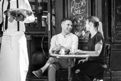 couple smiling at parisian cafe