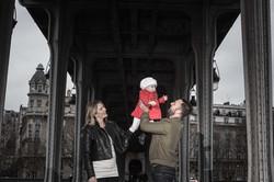parents with baby bir hakeim bridge