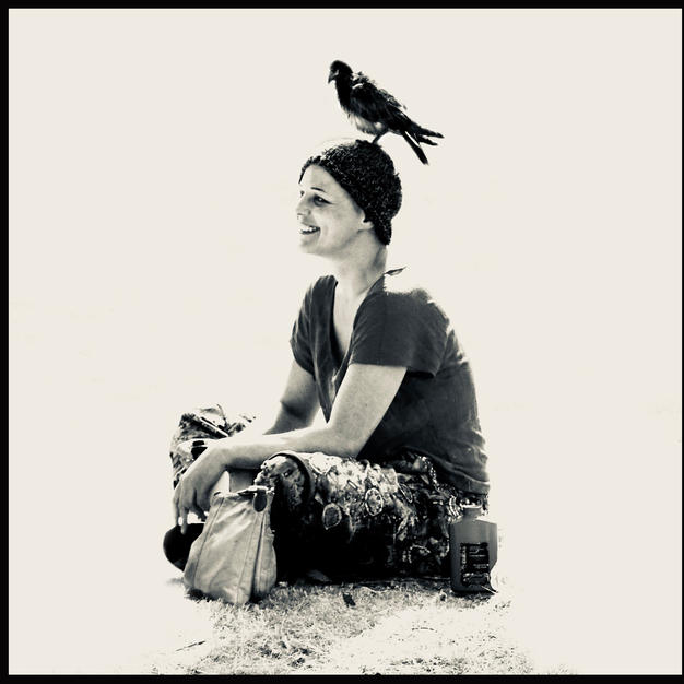 Woman With A Pigeon On Her Head