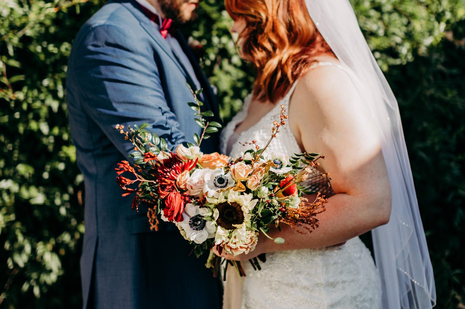 Memphis Wedding Couple holding Snapdragon bouquet