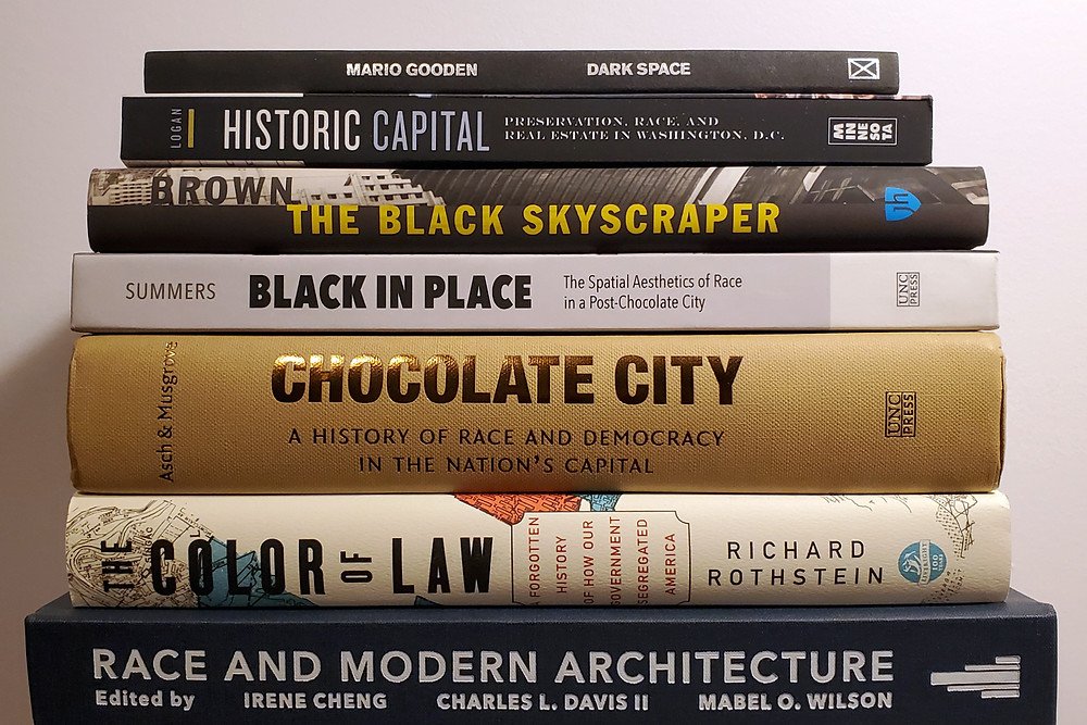 A stack of books on race and architecture; full list is in text below the image