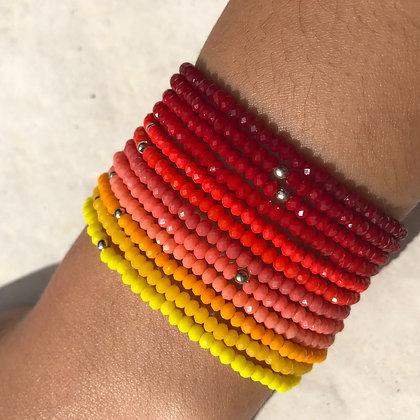 Le Perline nuance de rouge et de jaune