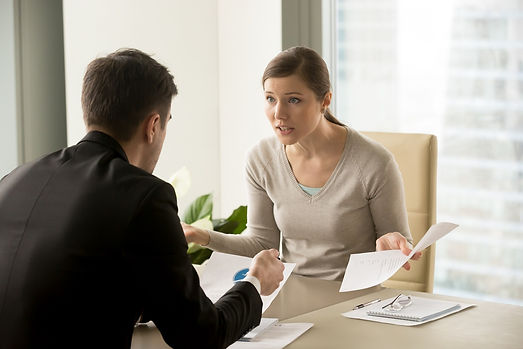 angry-businesswoman-arguing-with-busines