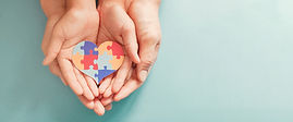 hands-holding-jigsaw-puzzle-heart-shape-world-autism-awareness-day.jpg