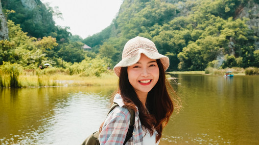 cheerful-young-traveler-asian-lady-with-