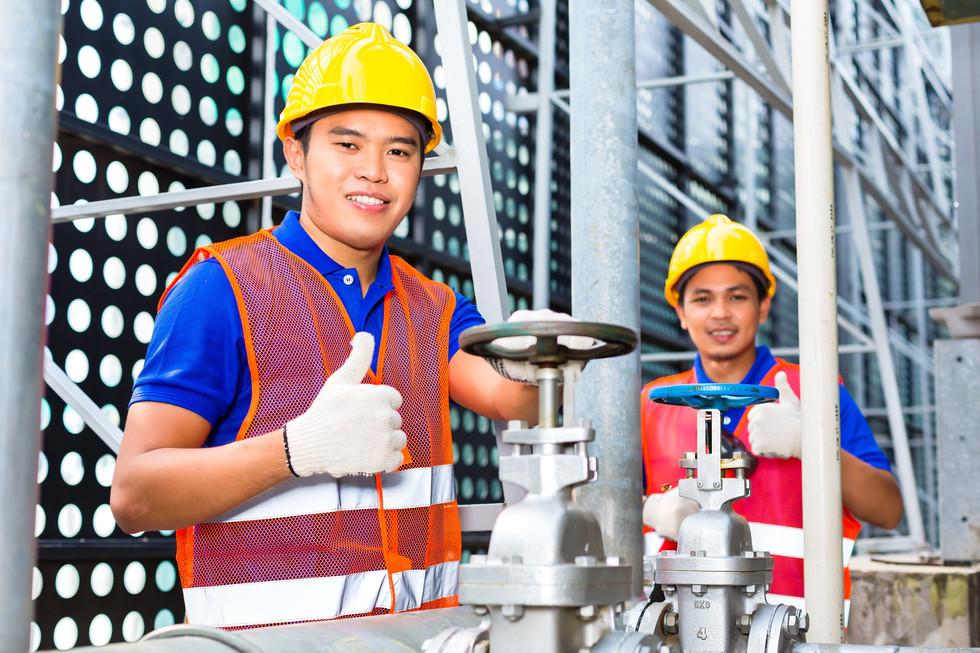 two-technicians-engineers-working-valve-