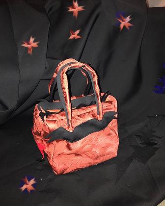 pinkred winged handbag