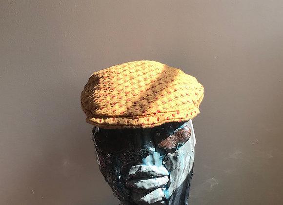 Gold flat cap