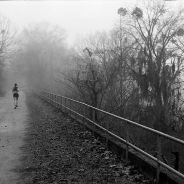 Lone runner and fog