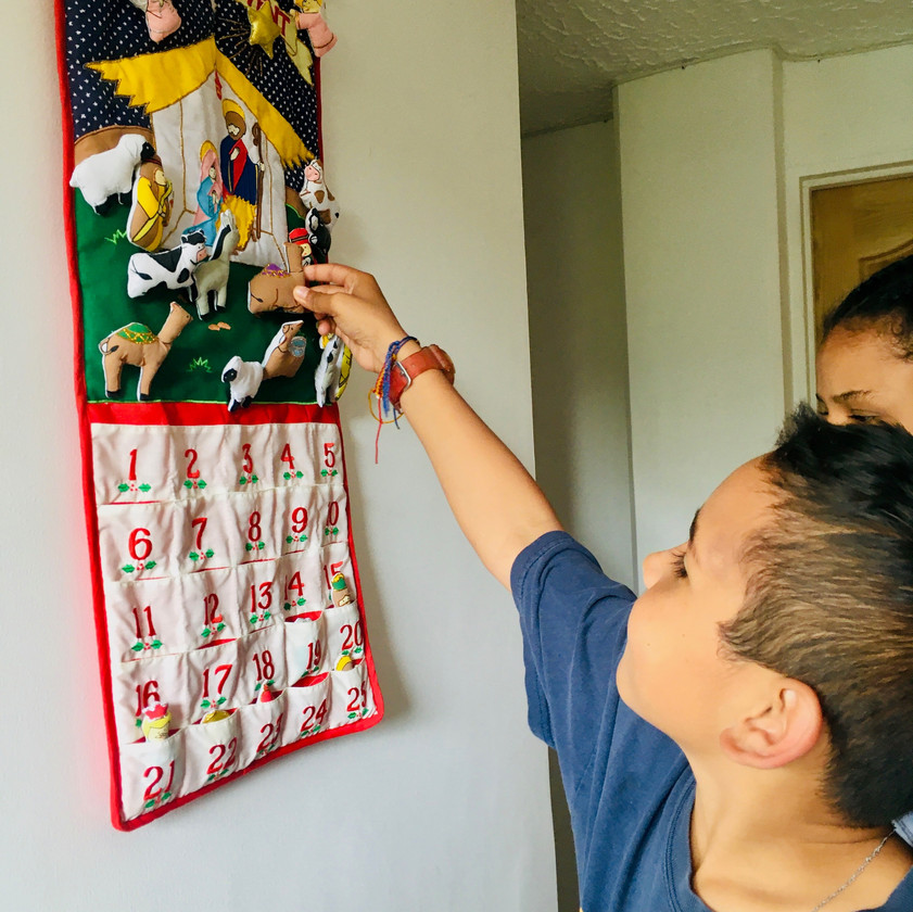 Eder putting up an animal on the Advent calendar.