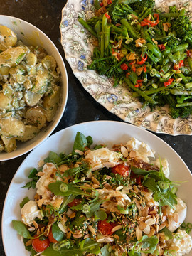 Selection of salads: Potato Salad with Cornichons, Chargrilled Broccoli with Garlic and Chilli, Roasted Tomatoes with Mozzarella